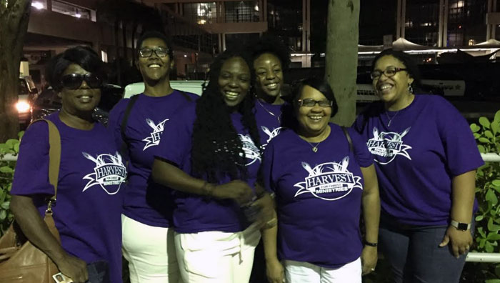 six women in blue Harvest Ministries t-shirts